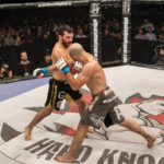 Hamilton MMA Fighter wins Hard Knocks Fighting Championship Belt.